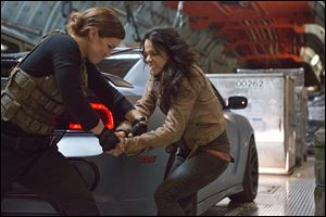 Gina Carano, left, and Michelle Rodriguez in a scene from