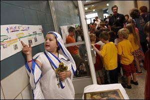 Isabella Karrip, 10, left, spoke about the life of Mother Teresa as she played the nun during the,
