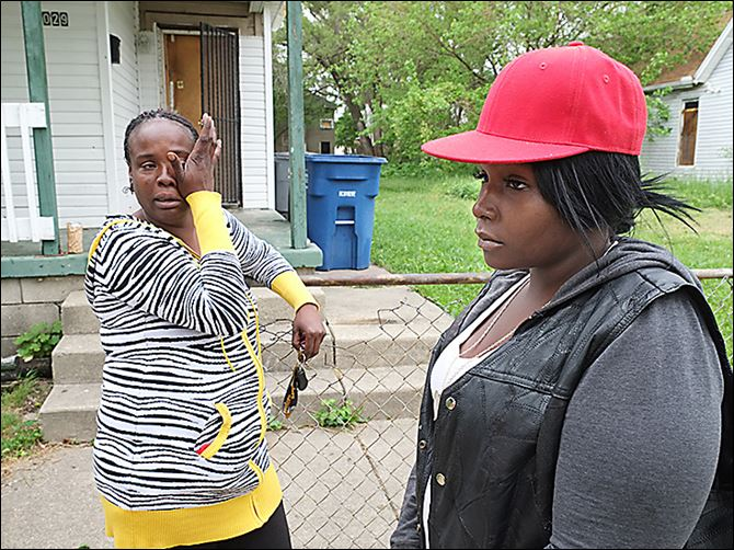 CTY shooting23p Darlene Woodmoore, left, and Tiffany Bean talk about the fatal shooting of Thomas Bean outside his home at 1029 Page St. Tiffany Bean is Thomas Bean's daughter; Ms. Woodmoore is his cousin.