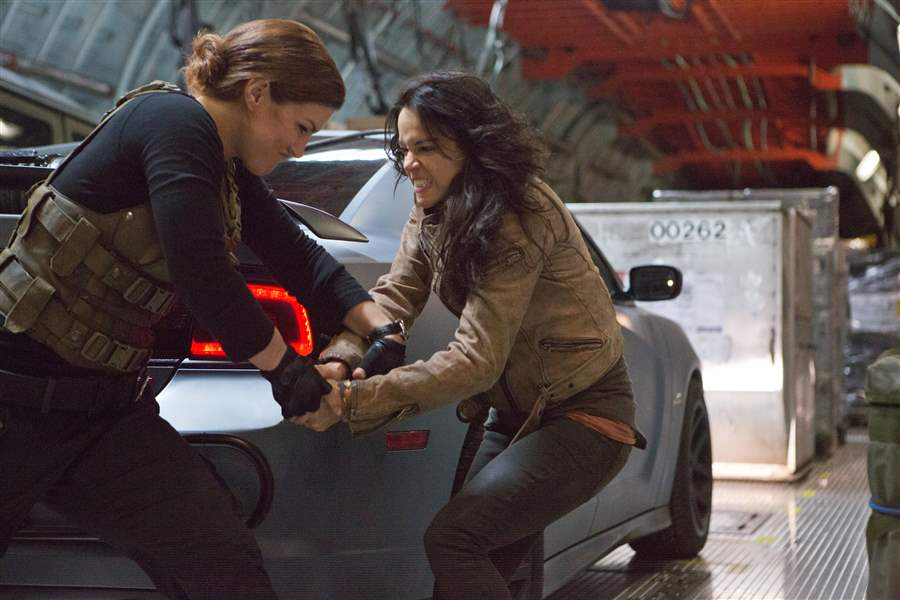 Gina-Carano-left-and-Michelle-Rodriguez-in-a-scene-from-Fast-Furious-6