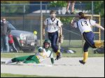 Hayley Schiavone scores for Clay in the second inning against Notre Dame  catcher Emily Novak in a Division I district final.