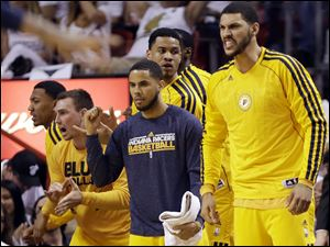 Indiana Pacers players cheer, from the bench, their team during the second half.