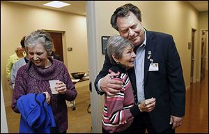 Dr. Lawrence Elmer hugs Jo Stockstiel of Holland during the open house of the Gardner-McMaster Parkinson Center at the University of Toledo's Health Science Campus. The advanced clinical treatment facility aims to be one of the nation's leading Parkinson's centers.