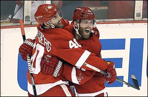 The Red Wings' Daniel Cleary, right, celebrates his empty-net goal with teammate Henrik Zetterberg. The veteran right wing said his team feels good with a 3-1 series lead.