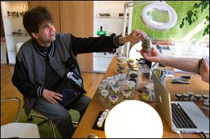 John Evans sells bags of medical marijuana to a dispensary employee in Ann Arbor. A proponent and user of medical marijuana, Mr. Evans moved to Michigan in 2010 from Colorado to become a registered caregiver, the term used for a legal grower of medical marijuana who supplies a registered patient.