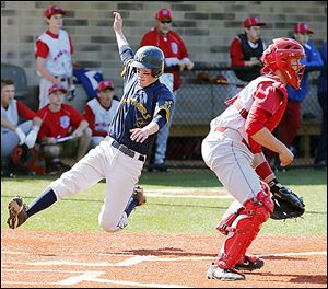 Whitmer's Kyle Craig scores behind St. Francis catcher Michael Wagner in Friday's district semifinal.