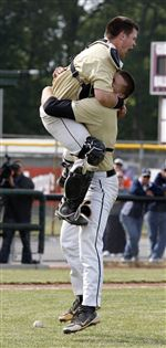 Perryburg-pitcher-Mark-Delas-19-right-hugs-catch