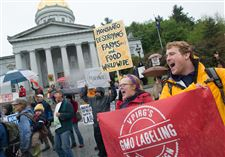 People-chant-and-carry-signs-during-a-protest-against-Monsanto