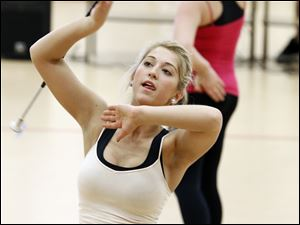 Suzy Carter,17,  of Perrysburg practices  twirling during a clinic put on by The Perrysburg Twirling Sophisticates.