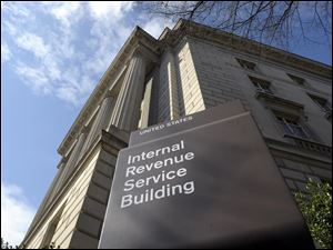 FILE - This March 22, 2013 file photo shows the exterior of the Internal Revenue Service building in Washington. No one answered the phone at the IRS hotline for tax help. Forget about advice on avoiding foreclosures at one of the Housing and Urban Development offices nationwide. Roughly five percent of the federal wor