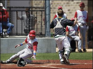 St. Francis senior Eric Zmuda scores behind Clay catcher Ty McAtee in Sa