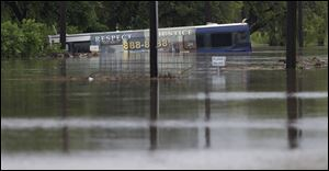 A San Antonio metro bus sits in floodwaters after it was swept off the road.