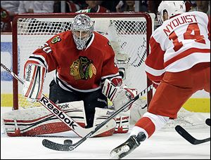 Chicago goaltender Corey Crawford blocks a shot by Detroit's Gustav Nyquist in Game 5 of the Western Conference semifinals.