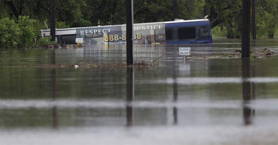 A-San-Antonio-metro-bus-sits-in-floodwaters-after-it-was-swept-off-the-road
