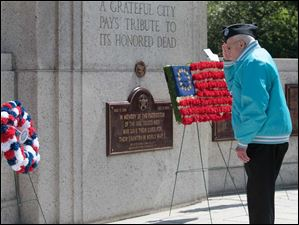 Korean War veteran Edward A. Auerbach, a member of the Korean War Veterans Association Chapter # 131, salutes after placing a wreath in remembrance of the Korean War dead.