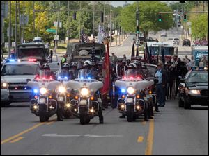 The annual Memorial Day parade is lead by the Toledo Police Department's motorcycle unit.