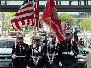Members of the United States Marine Corps carry the flags during the Memorial Day parade.