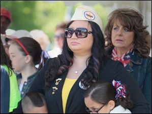 Veronica Mora and her son Topher Mora, 7,  left, and daughter Celina Mora, 9, during the service.