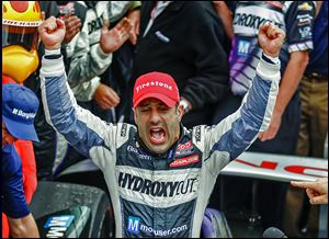 Tony Kanaan celebrates winning the Indianapolis 500 for the first time. His previous best finish was in 2004, when he finished second.