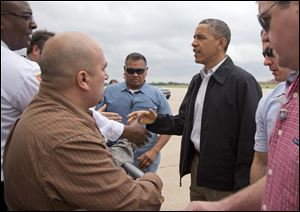 President Obama greets people on the tarmac as he arrives at Tinker Air Force Base in Midwest City, Okla., en route to the Moore, Okla., to see the response to the severe tornadoes and weather that devastated the area.