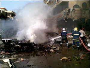 Iraqi firefighters distinguish a fire at the scene