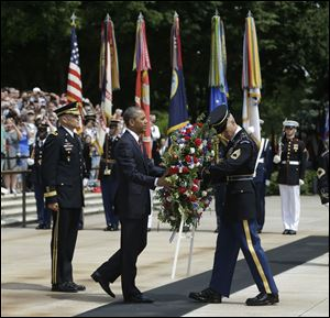 President Obama, center, participates in the wreathlaying ceremony at the Tomb of the Unknowns with Maj. Gen. Michael S. Linnington, left, Commander of the U.S. Army Military District of Washington, at Arlington National Cemetery on Memorial Day.