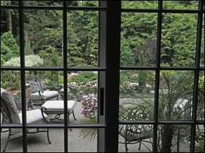 The sliding door leading out to Richard and Shelley Walinski's Ottawa Hills backyard garden.