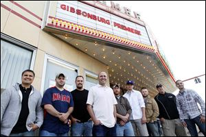 Members of the Golden Bears 2005 championship team who attended Sunday's premier of the movie 'Gibsonburg' include Brandon Beck, left, Josh Sanchez, Derek Hetrick, Coach Kyle Rase, Thom Brinker, Wyatt Kiser, Derek Eddings, Coach Brian Jackson, and Andy Gruner.