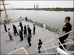 Marine Academy of Toledo cadets explore a deck during a tour of the State of Michigan, a training vessel for the Great Lakes Maritime Academy. The ship will return to Toledo next year.