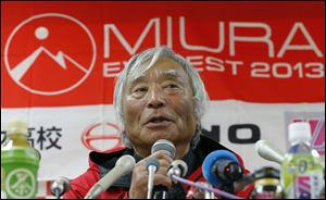 Yuichiro Miura, an 80-year-old Japanese mountaineer who became the oldest person to reach the top of Mount Everest last Thursday, speaks during a press conference at CLARK Memorial International High School in Tokyo today.