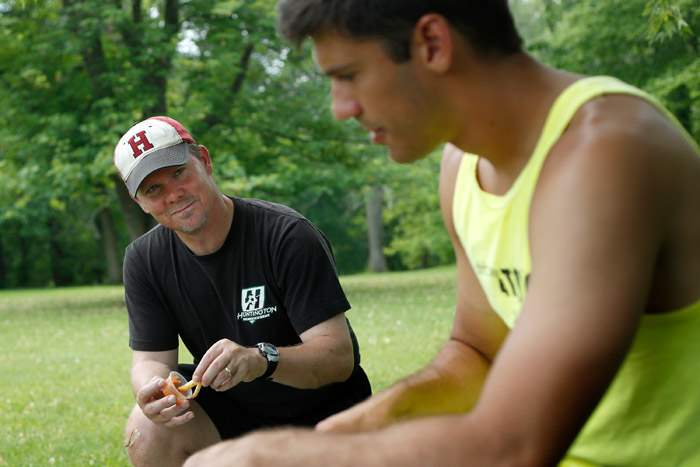 Soccer-coach-Russ-Lawson-left-talks-with-Isaac-Beal-right