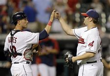 Cleveland-Indians-catcher-Yan-Gomes-left-and-relief-pitcher-Matt