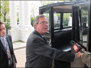 Former Florida Gov. Jeb Bush prepares to board a carriage after delivering a speech at the Mackinac Policy Conference on Mackinac Island this week.