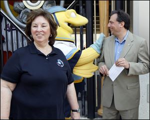 Linda Greene, president of ISOH/IMPACT, and Joe Napoli, president and general manager of the Mud Hens and Walleye say their respective organizations will work together to collect disaster relief supplies in a year-round program.