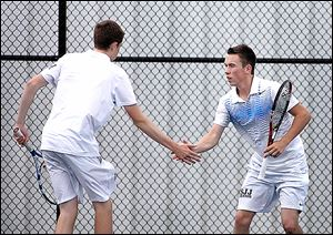 St. John's sophomore Kevin Brown, left, celebrates a point with his brother Ryan in a Division I state doubles match.