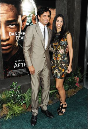 "Director M. Night Shyamalan and his wife Bhavna attend the ""After Earth"" premiere at the Ziegfeld Theatre on Wednesday in New York."