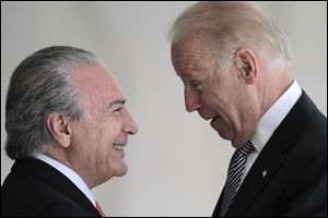 U.S. Vice President Joe Biden, right, talks with Brazil's Vice President Michel Temer.