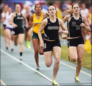 Emily Wyrick of Perrysburg wins the 800 meter run at the Division I regional track meet.