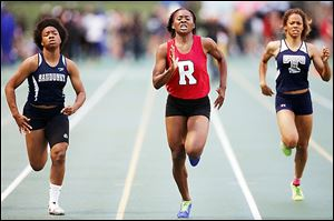 Sasha Dailey, center, of Rogers wins the 200-meter dash at the Division I regional track meet in Amherst, Ohio.
