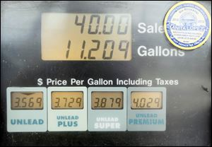 The Valero gas station on Monroe St. offers several grades of gasoline including regular and premium gas.