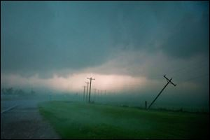 Tornadoes rolled in from the prairie and slammed Oklahoma City and its suburbs on Friday, killing a mother and baby and crumbling cars and tractor-trailers along a major interstate.