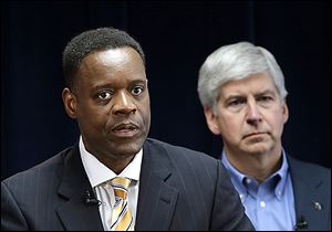 Emergency manager Kevyn Orr, left, and Michigan Gov. Rick Snyder have said they don't want to plunder the museum's vaults, but all city property must be identified for the people to whom the city is in debt.