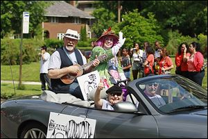 Members of Any Wednesday ride in harmony and in style during the parade Saturday at the the Historic Old West End Festival.