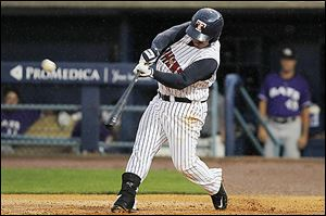 The Mud Hens' Ramon Cabrera takes a swing while at the plate. The Toledo catcher went 1-for-4 with a two-run single in the win over Louisville.