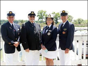 Commodores from the host clubs are, from left: J. Michael Walsh, Bay View Yacht Club, Barry Vi ncent, Toledo Yacht Club, Barb Pfleghaar, Toledo Sailing Club, and Ron Reeder, Maumee River Yacht Club, during the Opening of the Port ceremony at the Maumee River Yacht Club.