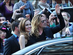 Angelina Jolie and Brad Pitt arrive at the World Premiere of 'World War Z' in London on Sunday.