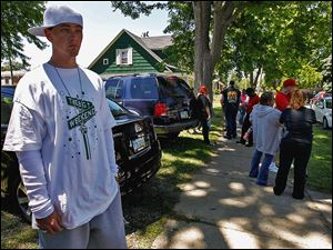 Terry Steinfurth talks about his missing daughter, 1½-year-old Elaina Steinfurth, as he and family and friends converge on the corner of Federal and Leonard streets in East Toledo.