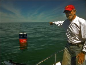 Mills Trophy Race chairman Ron Soka points out the location of  the Bicentennial Buoy marking the site of Commodore Perry's victory over the British in the Battle of Lake Erie. The buoy will mark part of the course.