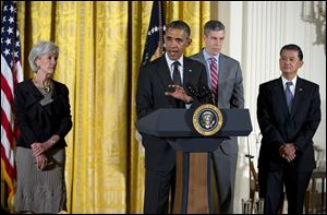 President Obama, accompanied by, from left, Health and Human Services Secretary Kathleen Sebelius, Education Secretary Arne Duncan, and Veterans Affai