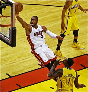 Miami's Dwyane Wade, who had 21 points, soars to the basket against Indiana's Lance Stephenson in Game 7 of the Eastern Conference fin